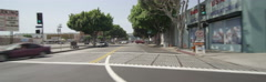 Front view of a Driving Plate: Car travels on Pico Boulevard in Los Angeles from Stock Footage