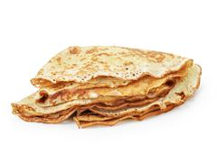 fresh hot blinis or crepes isolated - stock photo