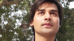 A close up portrait of an Indian young male Stock Footage