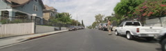 Front view of a Driving Plate: Car travels through a residential area on Bonnie - stock footage