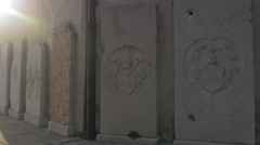 View of stone plaques with sculptures at Cattedrale di San Giusto Martire Stock Footage
