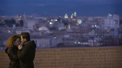 Couple kissing, urban landscape in the back Stock Footage