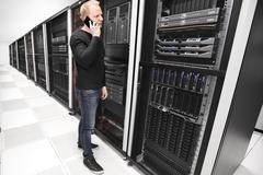 It consultant works in large enterprise datacenter - stock photo