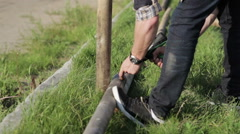 Man twists the screws Stock Footage