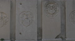 Stone plaques with sculptures at Cattedrale di an Giusto Martire in Trieste Stock Footage