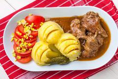 Roast turkey in gravy. Stock Photos