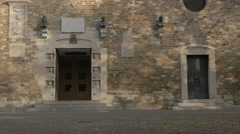 Doors and bust statues on San Giusto Martire Cathedral in Trieste Stock Footage