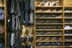 Shelves with shoes and accessories in clothes shop Stock Photos