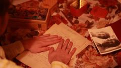 Man awakens memories reading old letters and looking at old photos - stock footage