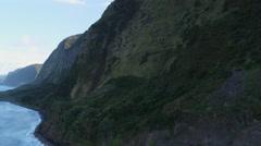 Close flight past wall of waterfalls on the Hawaiian coast. Shot in 2010. Stock Footage