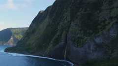 Close flight past a waterfall on a Hawaiian coastal cliff. Shot in 2010. Stock Footage