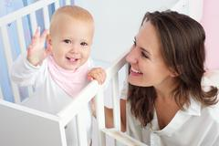 Happy mother and child with happy expression on face - stock photo