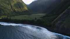 Flying from the sea into a green canyon along the Molokai coast. Shot in 2010. Stock Footage
