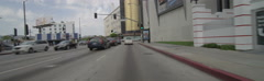 Front view of a Driving Plate: Car turns right from Fairfax Avenue onto Wilshire Stock Footage