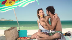 Romantic couple relaxing and having skewered fruits on beach Stock Footage