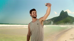 Stock Video Footage of Handsome man taking a selfie on smartphone at Ipanema beach