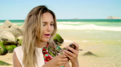 Attractive woman taking a selfie on smartphone at Ipanema beach Stock Footage