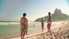 Stock Video Footage of Four friends playing football on Ipanema beach