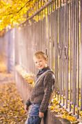 Boy having fun in urban city street on warm sunny fall day Stock Photos