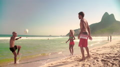 Stock Video Footage of Three friends playing football on Ipanema beach