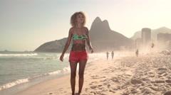 Attractive woman playing football at Ipanema beach - stock footage