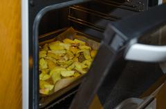 Glance into the oven Stock Photos