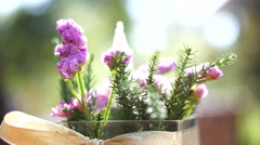 Table decorated with glass vase flowers on ribbon. Beautiful morning sun light Stock Footage