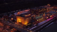 Aerial of Station Square in Pittsburgh at night from the Mon River Stock Footage