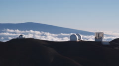 Past Mauna Loa Observatory with clouds in valley. Shot in 2010. Stock Footage