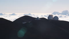 Mauna Loa Observatory with lens flares and a sea of clouds. Shot in 2010. Stock Footage