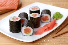 Maki sushi roll with salmon, wasabi, ginger and nori seaweed Stock Photos