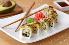 Green dragon sushi roll with eel, avocado, cucumber, wasabi and ginger - stock photo