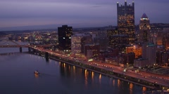 Aerial of Pittsburgh at night flying away from Point State Park Stock Footage