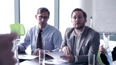 Business woman interacting with executives in conference room - stock footage