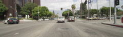 Front view of a Driving Plate: Car travels on Wilshire Boulevard in Los Angeles Stock Footage