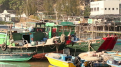 Fishing boats and stilt houses. Hong Kong. Stock Footage