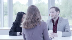 Business people having a discussion in cafeteria Stock Footage