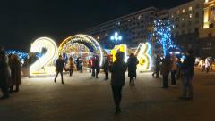 People and tourists walk along Moscow decorated for New Year Stock Footage