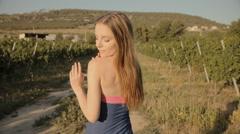 Cute girl walking through the vineyards Stock Footage