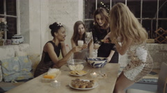Female friends at house party drinking and having fun Stock Footage