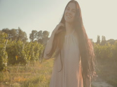 Girl in a light airy dress in the vineyards - stock footage