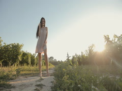 Lovely girl in a light airy dress posing in the vineyards - stock footage