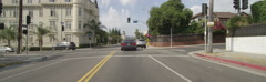 Front view of a Driving Plate: Car travels through residential area on Wilton Stock Footage