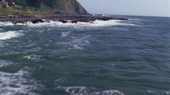Looking down onto waves pounding on the rocks Stock Footage