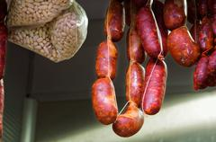 Beef and pork sausages on market - stock photo