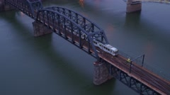 Aerial shot of subway crossing bridge over the Monongahela River in Pittsburgh Stock Footage