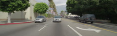 Rear view of a Driving Plate. Car travels west on Melrose Avenue from Windsor Stock Footage