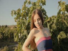 Beautiful young woman posing in the vineyards Stock Footage