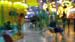 Children ride the carousel at Christmas / New Year's Fair Stock Footage