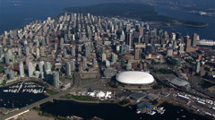 High, partial orbit of Vancouver, British Columbia, at a distance; BC Place Stock Footage